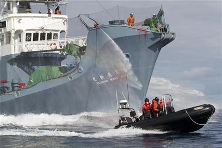 Japanese whaling fleet vessel Yushin Maru No. 3 sprays water cannons at Sea Shepherd activists in a dinghy boat during their clashes in the Southern Ocean
